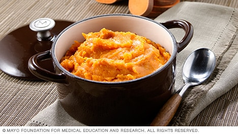 Mashed sweet potatoes in a small pot