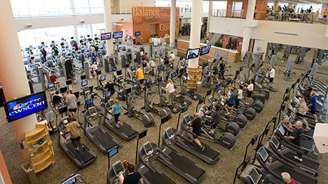 The main fitness floor includes cardio and strength training equipment.