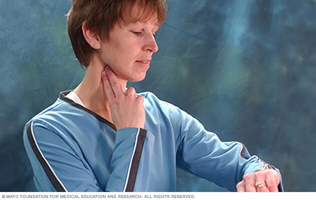 Photo of woman checking her pulse over the carotid artery