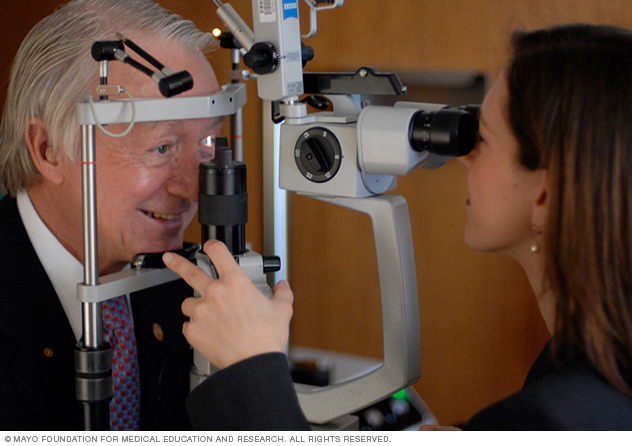 A man undergoing slit-lamp examination