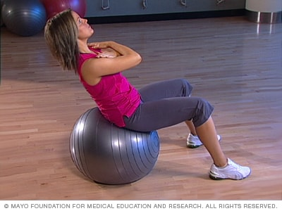 Photo of woman doing an abdominal crunch with a fitness ball