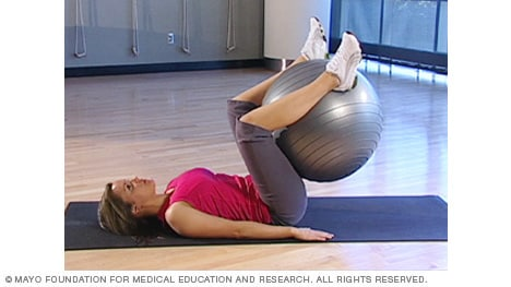 Photo of woman doing abdominal ball raise with fitness ball