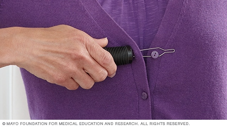 Photo of a device that helps button clothes.