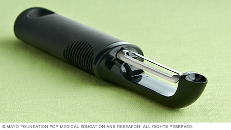 Photo of a vegetable peeler with a large, cushioned handle.