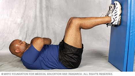 Photo of man doing abdominal crunch core-strength exercise
