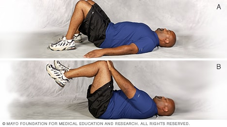 Photo of man doing double-leg abdominal press core-strength exercise