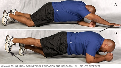 Photo of man doing modified plank core-strength exercise variations