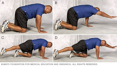 Photo of man doing quadruped core-strength exercise