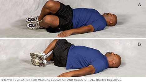 Photo of man doing segmental rotation core-strength exercise