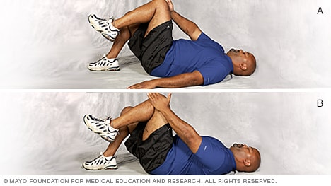 Photo of man doing variations of single-leg abdominal press core-strength exercise