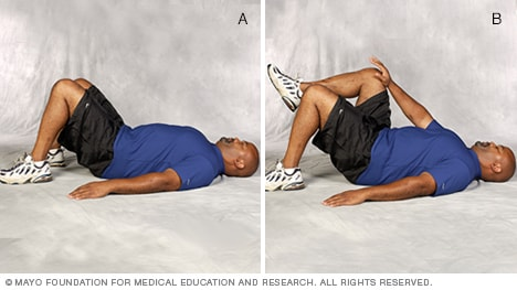 Photo of man doing single-leg abdominal press core-strength exercise
