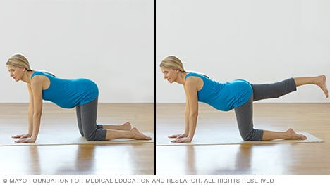 Pregnancy exercises — pregnant woman practicing leg lifts