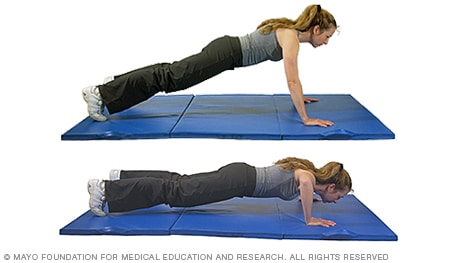 Photo of woman doing pushup