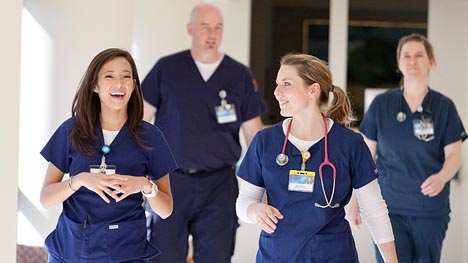 Photo of two Mayo Clinic nurses talking in hallway
