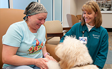 Photo of Mayo Clinic volunteer, patient and dog