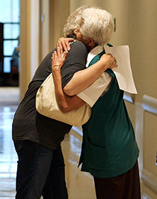 Photo of Mayo Clinic volunteer hugging a patient