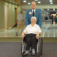 Photo of Mayo Clinic volunteer and a patient in wheelchair