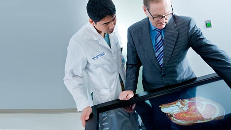 Two Mayo Clinic physicians looking at a brain scan image