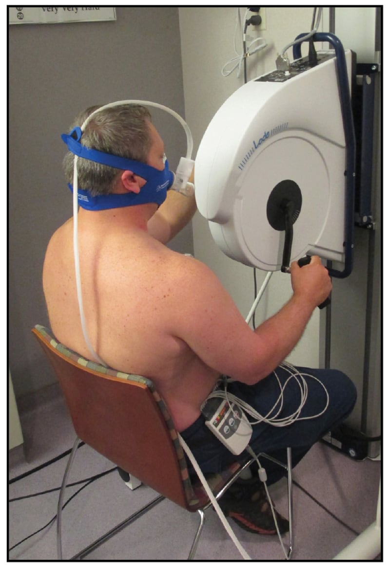 Image of seated arm ergometer stress testing with oxygen consumption