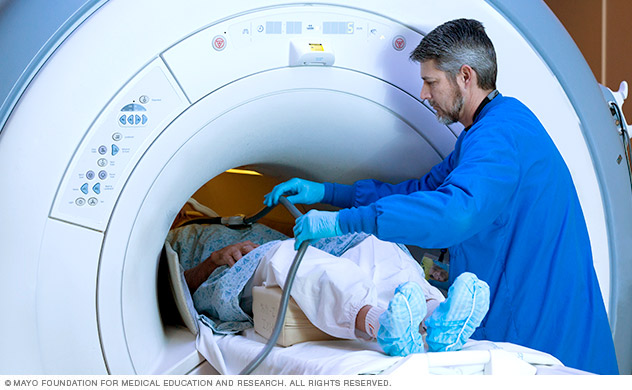 An MRI is administered to a person.