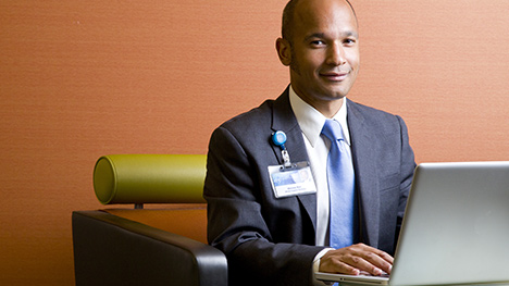 Photo of Mayo Clinic employee at a laptop