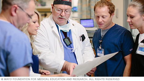 Photo of Mayo Clinic student nurses talking with physician
