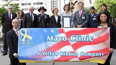 Mayo Clinic leadership with Beyond the Yellow Ribbon banner