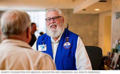 Mayo Clinic volunteer at information desk