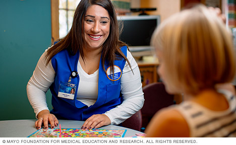 Mayo Clinic volunteer with pediatric patient