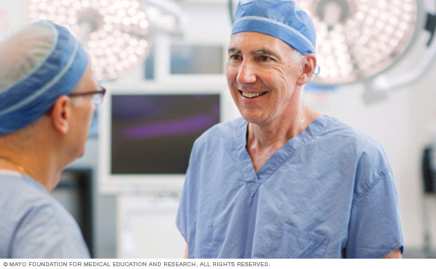 Two surgeons in a discussion in an operating room.