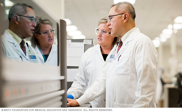 Hepatitis C researchers working in lab