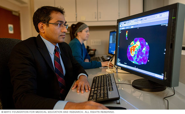 Photograph of doctor viewing a magnetic resonance elastogram