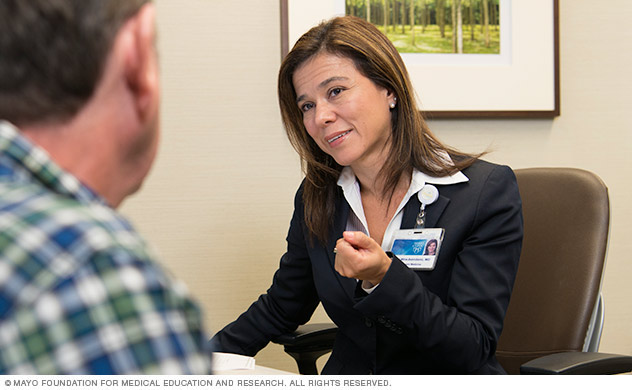 A doctor talking with a person