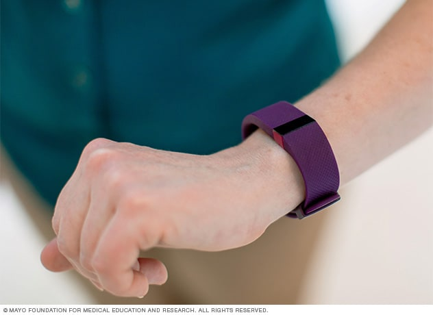 Woman wearing an activity tracker on her wrist