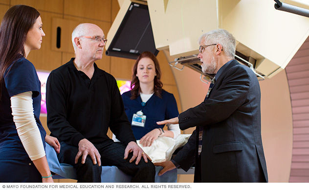 Mayo care team and patient discuss proton beam procedure