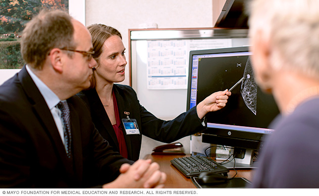 Image of doctor points out breast cancer lesion to patient