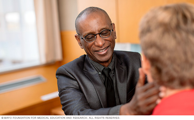 A Mayo Clinic physician consults with a man about acute myelogenous leukemia care