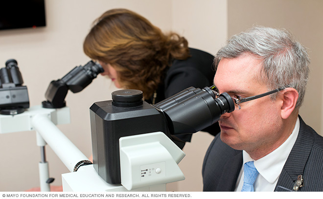Dermatologists read pathology slides to ensure an accurate diagnosis.