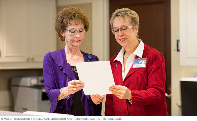 Two Suites at St. Marys staff members review a personalized preferences sheet.