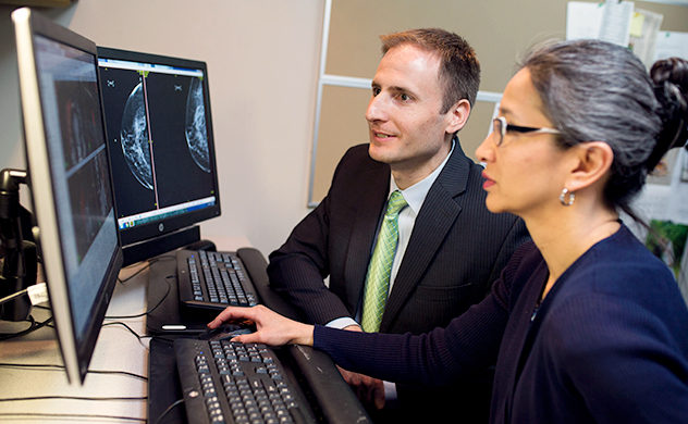 Doctors review mammography scans