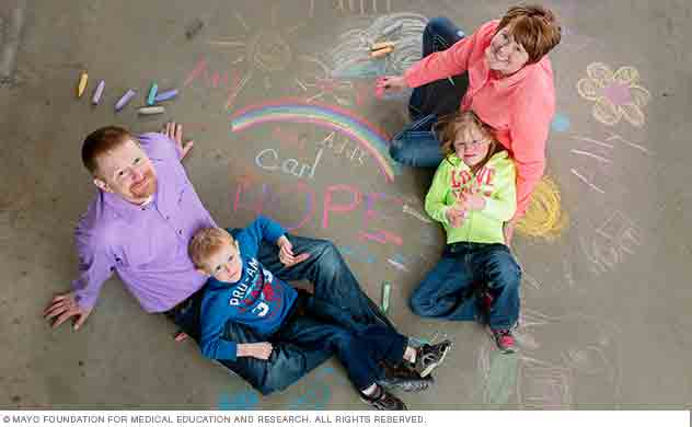 Parents and child participants complete a creative exercise using chalk.