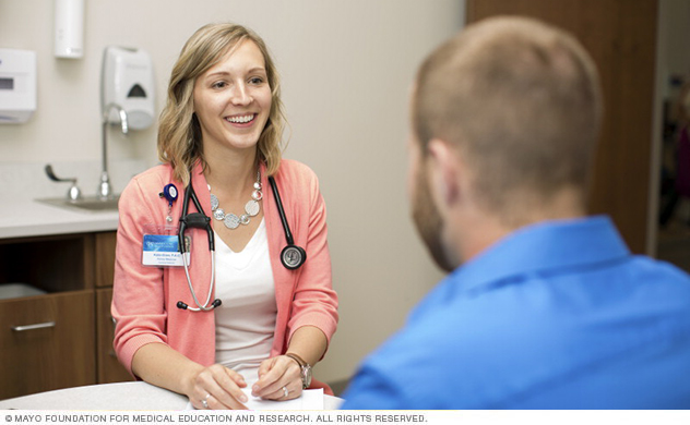 A Mayo Clinic allergy specialist consults with a patient