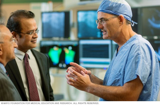 Members of Mayo Clinic's cardiovascular medicine team work together to bring artificial intelligence innovations into clinical practice.