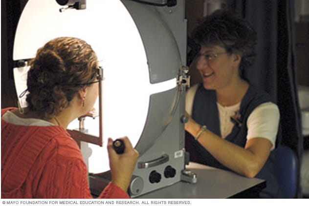 A woman undergoing manual visual field testing