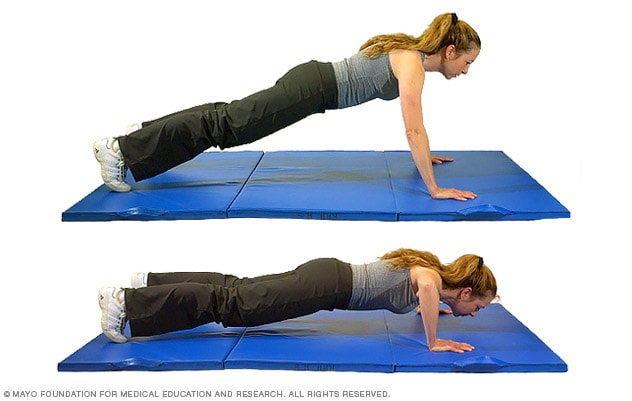 Photo of woman doing a classic pushup