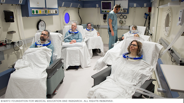 Image showing person wearing hood to receive hyperbaric oxygen therapy