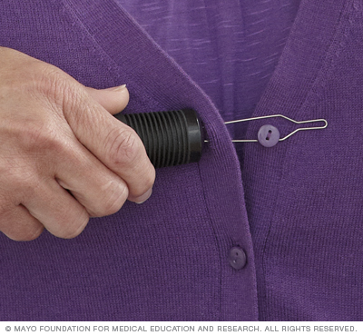 Photograph of a person using a buttonhook