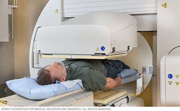 Photograph of a person undergoing a SPECT scan