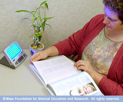 Image showing woman undergoing light therapy for seasonal affective disorder