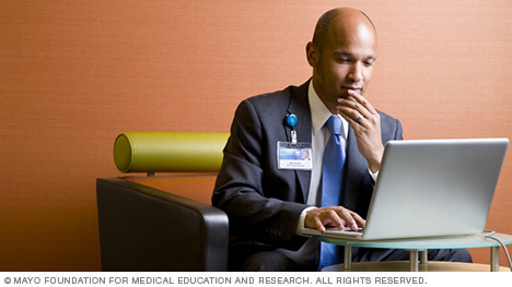 Photo of a Mayo Clinic employee at a computer